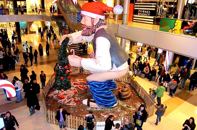 Weird Christmas Traditions: Spain's Caganer & Caga Tió